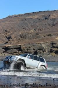 Vikings driving through water